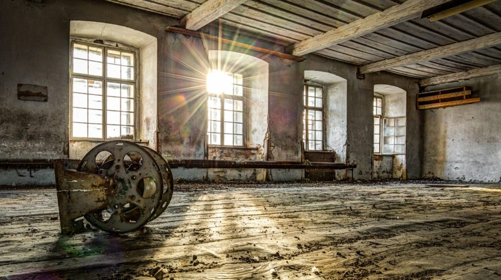 Afternoon sun twinkling through the windows of an abandoned weaving mill